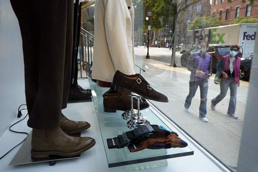 Consumer Confidence FILE - In this Tuesday, Sept. 15, 2020, file photo, passers-by examine a storefront window in Boston's fashionable Newbury Street shopping district. (AP Photo/Steven Senne) (Steven Senne STF)