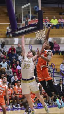Mike Moore | The Journal Gazette  New Haven forward Thomas Latham averaged 11.9 points and 7.1 rebounds last season and will try to lead New Haven to a second straight sectional crown and an NE8 conference title.