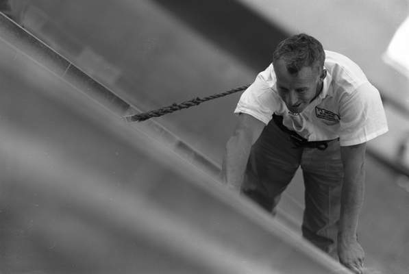 July 26, 1962: Window washer Pete Malott hangs off the side of Lincoln Tower's 17th floor by safety belts hooked to knobs at the side of the windows.