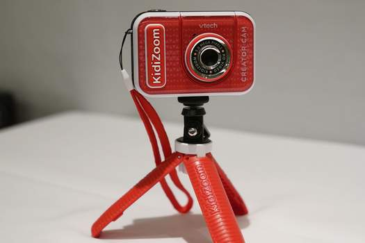 Virus Outbreak-Holiday Trends A KidiZoom Creator Cam by VTech is displayed at the Toy Fair, Thursday, Sept. 17, 2020, in New York. The digital camera comes with a green screen and animated backgrounds allowing kids to go to outer space, get chased by T-Rex, or make things disappear. The camera comes with a tabletop tripod, which can also be used as a selfie stick. (AP Photo/Kathy Willens) (Kathy Willens STF)