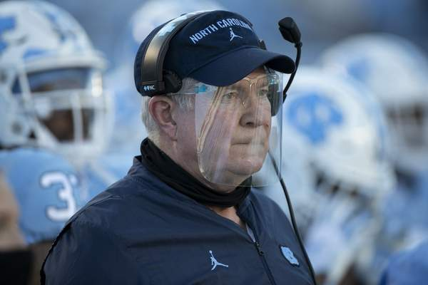 North Carolina coach Mack Brown, wearing a faceshield, watches his team in the first quarter against Notre Dame during an NCAA college football game, Friday, Nov. 27, 2020, at Kenan Stadium in Chapel Hill, N.C. (Robert Willett/The News & Observer via AP)