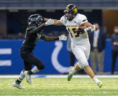 11282020_FB_SouthAdams_CovenantChristian_24 South Adams High School senior Nicholas Miller (15) tries to break free of the tackle of Covenant Christian High School senior Jay Wright (24) during the second half. South Adams and Covenant Christian high schools competed in the 48th Annual IHSAA Class A Football State Finals, Saturday, Nov. 28, 2020, at Lucas Oil Stadium, in Indianapolis. Covenant Christian won 41-40. (Doug McSchooler/Special to The Journal Gazette) (Doug McSchooler freelance)