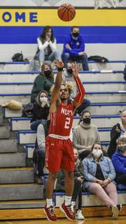 Mike Moore   The Journal Gazette North Side guard Ronald Collins shoots the ball in the second quarter against Blackhawk at Blackhawk Christian High School on Tuesday.