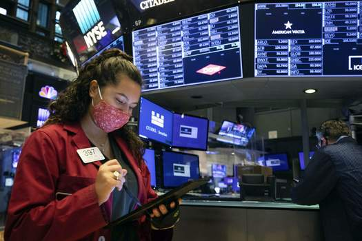 Financial Markets Wall Street Associated Press Trader Ashley Lara uses her handheld device as she works on the trading floor Tuesday. The S&P 500 and Nasdaq composite reached new highs as the stocks ramp higher on news of a possible coronavirus vaccine. (Colin ZiemerHONS)