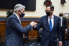 House Banking Associated Press Federal Reserve Chairman Jerome Powell fist bumps Treasury Secretary Steven Mnuchin after a House Financial Services Committee hearing Wednesday on Capitol Hill in Washington. Both leaders urged Congress to pass more virus relief. (Jim Lo ScalzoPOOL)