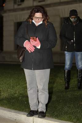Rachel Bellwood | The Journal Gazette  Amy Miller-Davis reads a prayer during the Angel Anniversary Vigil honoring Codi McCann in front of the Allen County Courthouse on Saturday.