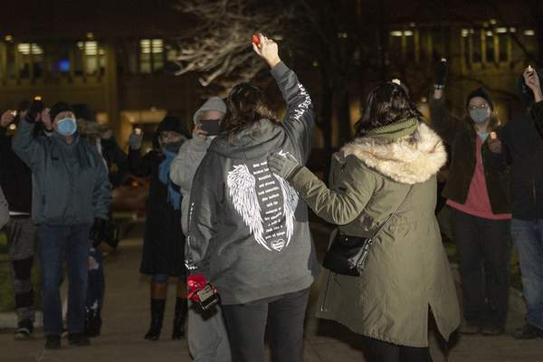 Rachel Bellwood | The Journal Gazette  Stacey Davis and her daughter Lynsee Davis gather with community membersto honor her son, Codi McCann, during the Angel Anniversary Vigil in front of the Allen County Courthouse on Saturday.