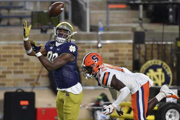Notre Dame wide receiver Javon McKinley (88) catches a pass for a touchdown in front of Syracuse cornerback Garett Williams (14) in the second half of an NCAA college football game Saturday, Dec. 5, 2020, in South Bend, Ind. (Matt Cashore/Pool Photo via AP)