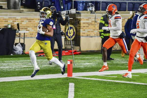Notre Dame running back Chris Tyree (25) scores in the second half of an NCAA college football game Saturday, Dec. 5, 2020, in South Bend, Ind. (Matt Cashore/Pool Photo via AP)