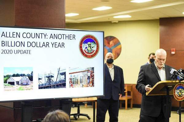 Katie Fyfe | The Journal Gazette   Commissioner Nelson Peters announces the year-end report on local residential and commercial development at a news conference Monday at Citizens Square.