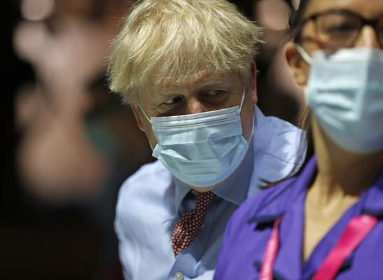 British Prime Minister Boris Johnson arrives to see the Pfizer-BioNTech COVID-19 vaccine being administered at Guy's Hospital in London, Tuesday, Dec. 8, 2020. (AP Photo/Frank Augstein, Pool)