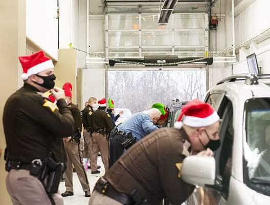 Katie Fyfe   The Journal Gazette The Fort Wayne Police  and  Allen County Sheriff's departments hand out toys during a toy giveaway hosted by Vorderman Volkswagen on Saturday morning.