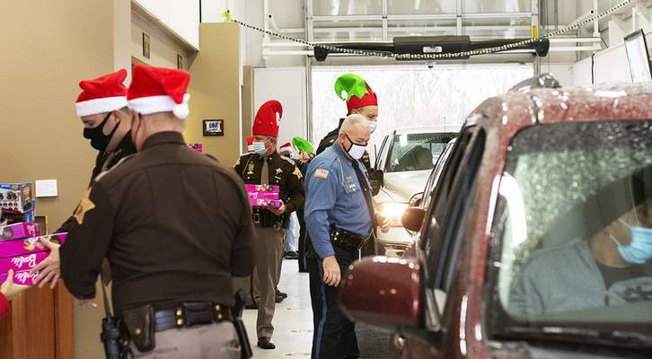 Katie Fyfe   The Journal Gazette The Fort Wayne Police Department and the Allen County Sheriff's Department hand out toys during a toy giveaway hosted by Vorderman Volkswagen partnered with First Responders Children's Foundation based in New York at Vorderman Volkswagen on Saturday morning.
