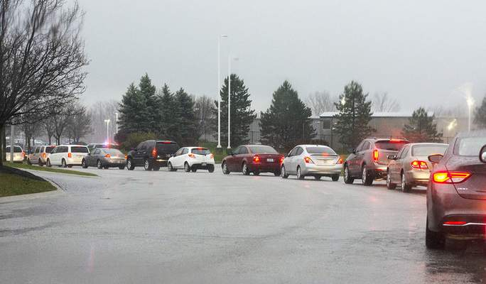 Katie Fyfe   The Journal Gazette A long line of cars goes down the street during a toy giveaway hosted by Vorderman Volkswagen partnered with First Responders Children's Foundation based in New York at Vorderman Volkswagen on Saturday morning.