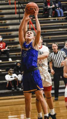Mike Moore | The Journal Gazette Homestead guard Fletcher Loyer goes up under the basket in the first period against Bishop Luers on Friday.