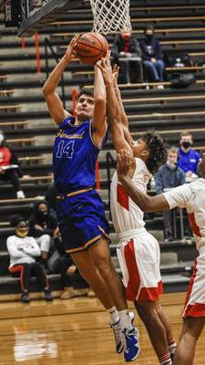 Mike Moore | The Journal Gazette Homestead forward Kaleb Kolpien goes up under the basket in the first period against Bishop Luers on Friday.
