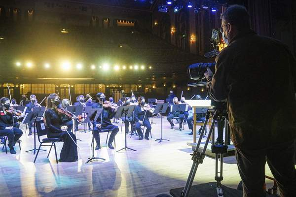 Mike Moore | The Journal Gazette Punch Films CEO Derek Devine films musicians from the Fort Wayne Philharmonic this month at Embassy Theatre for the Virtual Holiday Spectacular. The show can be streamed on Facebook beginning at 8 p.m. Sunday.