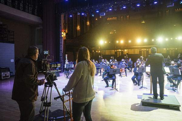 Mike Moore | The Journal Gazette  Punch Films CEO Derek Devine leads filming of musicians from Fort Wayne Philharmonic for the Virtual Holiday Spectacular on Dec.7 at Embassy Theatre.