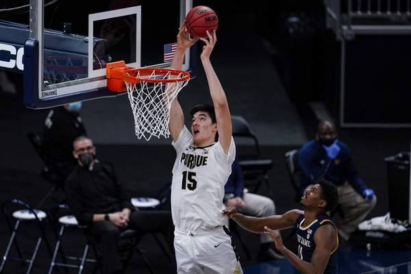 Purdue center Zach Edey (15) goes up for a shot in front of Notre Dame forward Juwan Durham (11) in the first half of an NCAA college basketball game in Indianapolis, Saturday, Dec. 19, 2020. (AP Photo/Michael Conroy)