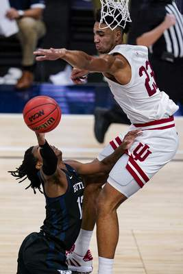 Indiana forward Trayce Jackson-Davis (23) blocks the shot of Butler guard Myles Tate (12) in the second half of an NCAA college basketball game in Indianapolis, Saturday, Dec. 19, 2020. (AP Photo/Michael Conroy)