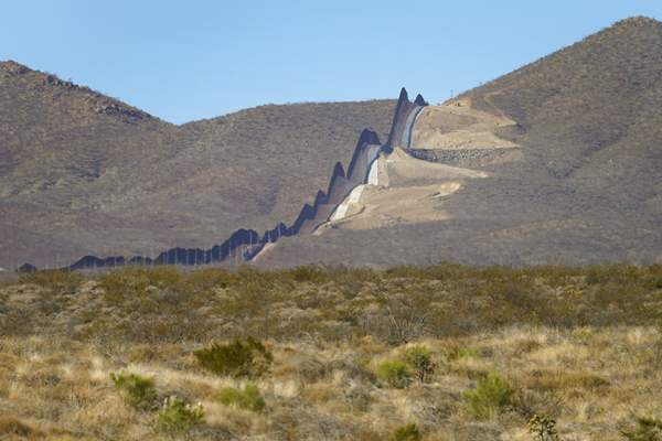 Associated Press Newly erected border wall separating Mexico, left, and the U.S., cuts through the Sonoran Desert just west of the San Bernardino National Wildlife Refuge on Wednesday.