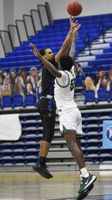 Mike Moore | The Journal Gazette Purdue Fort Wayne guard Jarred Godfrey takes a shot at the basket on Sunday in the second half against Cleveland State at Gates Sports Center.