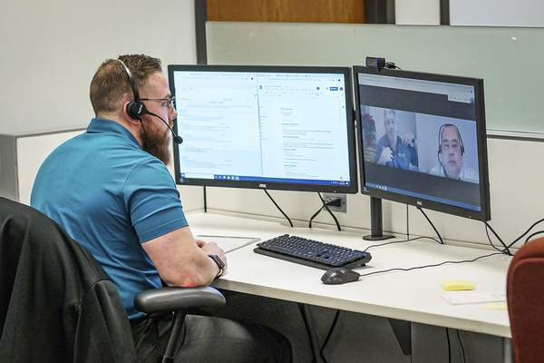 Mike Moore | The Journal Gazette Circle Logistics recruiter Zach Reinig on a conference call on Friday 12.11.20