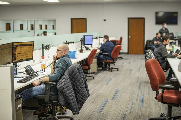 Mike Moore | The Journal Gazette Employees work at their desks at Circle Logistics on Friday 12.11.20