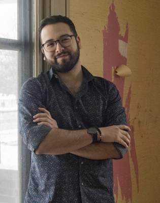 Michelle Davies | The Journal Gazette Aaron Robles, volunteer with St. Joseph Missions in the shelter, which is undergoing renovations as they expand services.