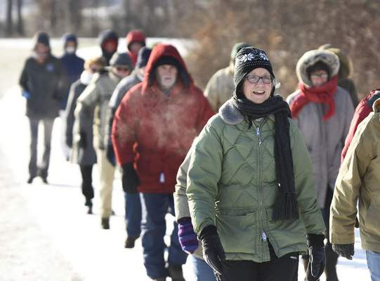 Dress warm and maintain social distancing if participating on a First Day Hike. The Indiana DNR is encouraging hikers to share their experiences on the Indiana State Parks Facebook page. These hikers are walking along the PufferBelly Trail near Salomon Farm Park.