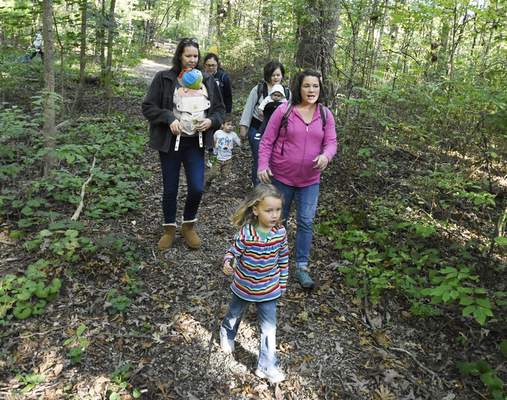 Rachel Von Stroup | The Journal Gazette Members hike the trail during Hike It Baby at Lindenwood Nature Preserve on Thursday October 10, 2019.