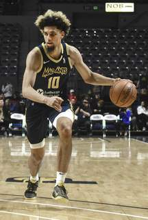 Michelle Davies | The Journal Gazette  Mad Ants' Brian Bowen II brings the ball down the court against Westchester at the Memorial Coliseum last season.