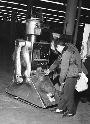 March 23, 1962: George Petersen and Kevin C. Craig, students at L.C. Ward School, take a look at a robot as projects were being set up for the Northeastern Indiana Science Fair at Allen County Memorial Coliseum. (Journal Gazette file photo)