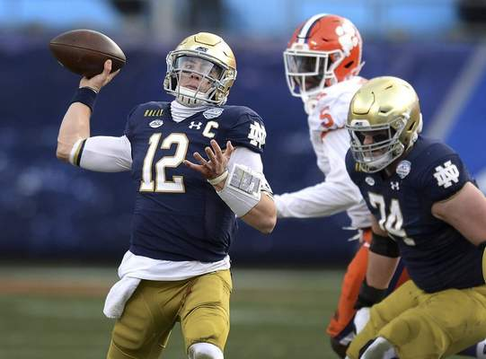 Associated Press Quarterback Ian Book and his Notre Dame teammates will look to silence critics as the team faces the Alabama Crimson Tide today in the College Football Playoff semifinal at the Rose Bowl in Pasadena, Calif.