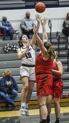 Mike Moore | The Journal Gazette Bellmont senior Lauren Blake goes up under the basket in the second period against Bluffton on Saturday.