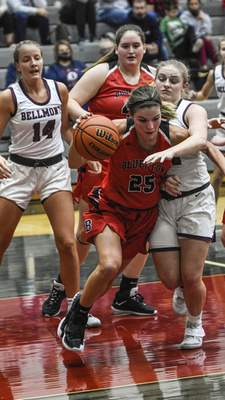 Mike Moore | The Journal Gazette Bluffton senior Emma Boots grabs a rebound in the second period against Bellmont at Bellmont High School on Saturday.