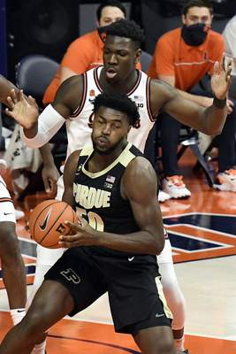 Purdue's forward Trevion Williams (50) is pressured by Illinois center Kofi Cockburn (21) in the first half of an NCAA college basketball game Saturday, Jan. 2, 2021, in Champaign, Ill. (AP Photo/Holly Hart)