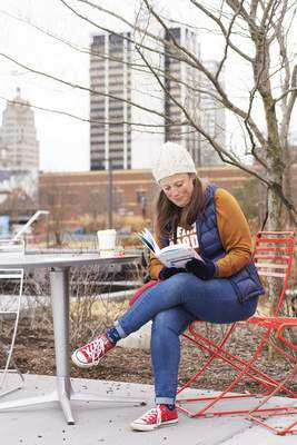 Katie Fyfe | The Journal Gazette Tina Haag enjoys a book in Promenade Park on Sunday afternoon.