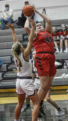 Mike Moore | The Journal Gazette  Bluffton senior Zoe Barger goes up under the basket in the firstquarter against Bellmont at Bellmont High School on Saturday.