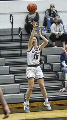 Mike Moore | The Journal Gazette  Bellmont senior Lauren Blake takes a jump shot on Saturday in the second quarter against Bluffton.