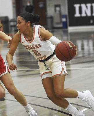 Katie Fyfe   The Journal Gazette  Indiana Tech senior Taya Andrews drives to the basket during the first quarter against Indiana Wesleyan at the Schaefer Center on Saturday.