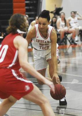 Katie Fyfe   The Journal Gazette  Indiana Tech senior Alexis Hill brings the ball down the court during the second quarter against Indiana Wesleyan at Schaefer Center on Saturday.