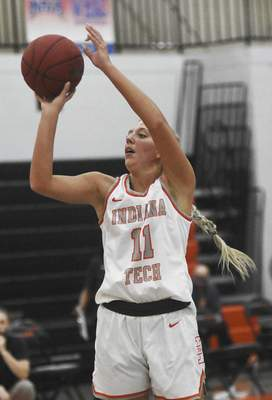 Katie Fyfe   The Journal Gazette  Indiana Tech sophomore Erika Foy takes a shot during the first quarter against Indiana Wesleyan at the Schaefer Center on Saturday.