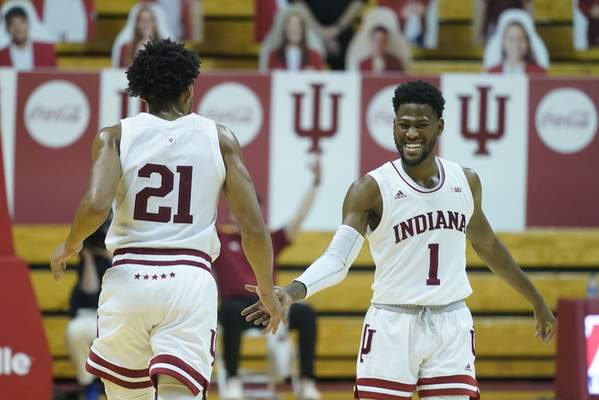 Indiana forward Jerome Hunter (21) and Al Durham (1) react during the second half of an NCAA college basketball game against Maryland, Monday, Jan. 4, 2021, in Bloomington, Ind. (AP Photo/Darron Cummings)