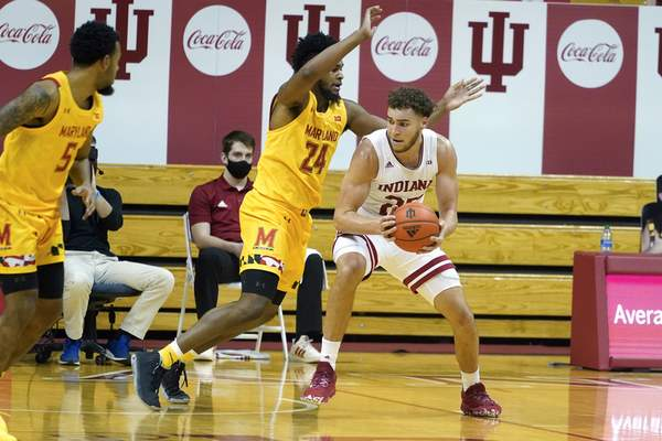 Indiana forward Race Thompson (25) drives to the basket against Maryland forward Donta Scott (24) during the first half of an NCAA college basketball game, Monday, Jan. 4, 2021, in Bloomington, Ind. (AP Photo/Darron Cummings)