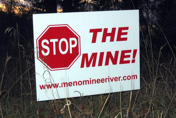 Associated Press This 2008 photo in Menominee County, Mich., shows the long-standing opposition to plans for an open-pit mine in the state's Upper Peninsula.