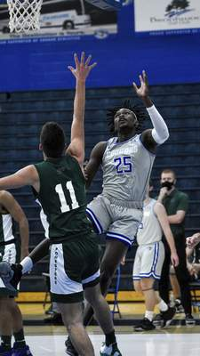 Mike Moore | The Journal Gazette Saint Francis forward David Ejah takes a shot at the basket in the first half against Huntington University at the Hutzell Athletic Center on Wednesday.