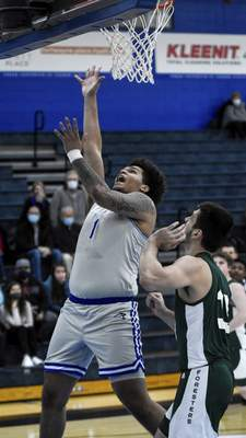 Mike Moore | The Journal Gazette Saint Francis center James Anderson scores under the basket in the first half against Huntington University at the Hutzell Athletic Center on Wednesday.