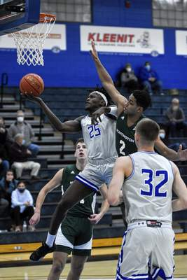 Mike Moore | The Journal Gazette Saint Francis forward David Ejah scores a layup in the first half against Huntington University at the Hutzell Athletic Center on Wednesday.