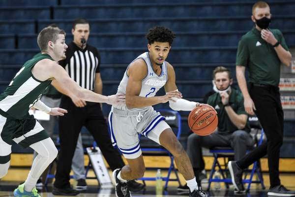 Mike Moore | The Journal Gazette Saint Francis guard Jalan Mull in the first half against Huntington University at the Hutzell Athletic Center on Wednesday.